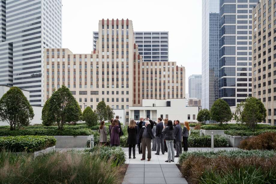People look at the rooftop terrace at BG Group Place at 811 Main St, Wednesday, Dec. 11, 2013, in Houston.  The building is one of several real estate developments that are finalists in the Urban Land Institutes's 2013 Development of Distinction Awards. Photo: Michael Paulsen, Houston Chronicle