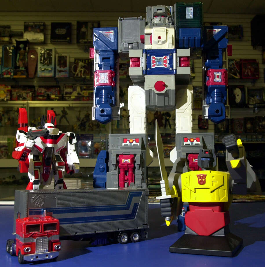 Transformers Optimus Prime, Jetfire, Fortress Maximus and a bust of Grimlock are seen Nov. 2, 2003, at Alien Worlds. The toys and the animated show were introduced in 1984. Photo: EDWARD A. ORNELAS, San Antonio Express-News / SAN ANTONIO EXPRESS-NEWS