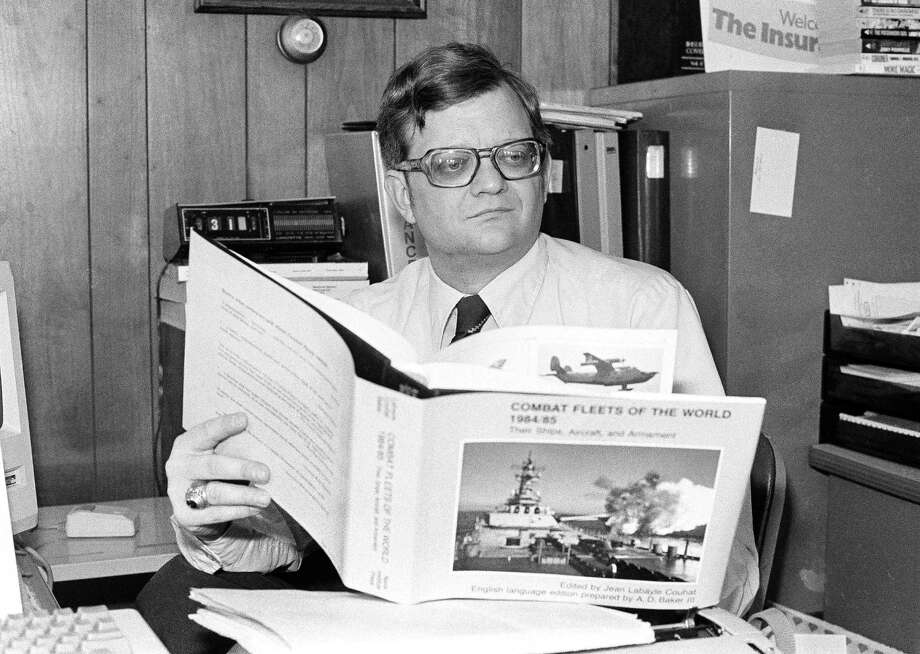 """Tom Clancy, a 37-year-old insurance broker and frustrated writer from a small, rural town in southern Maryland does research on his next book March 12, 1985, in Prince Frederick, Md. Clancy's """"The Hunt For Red October"""" was an instant success and had President Reagan among its readers. Photo: Bill Smith, Associated Press / AP1985"""