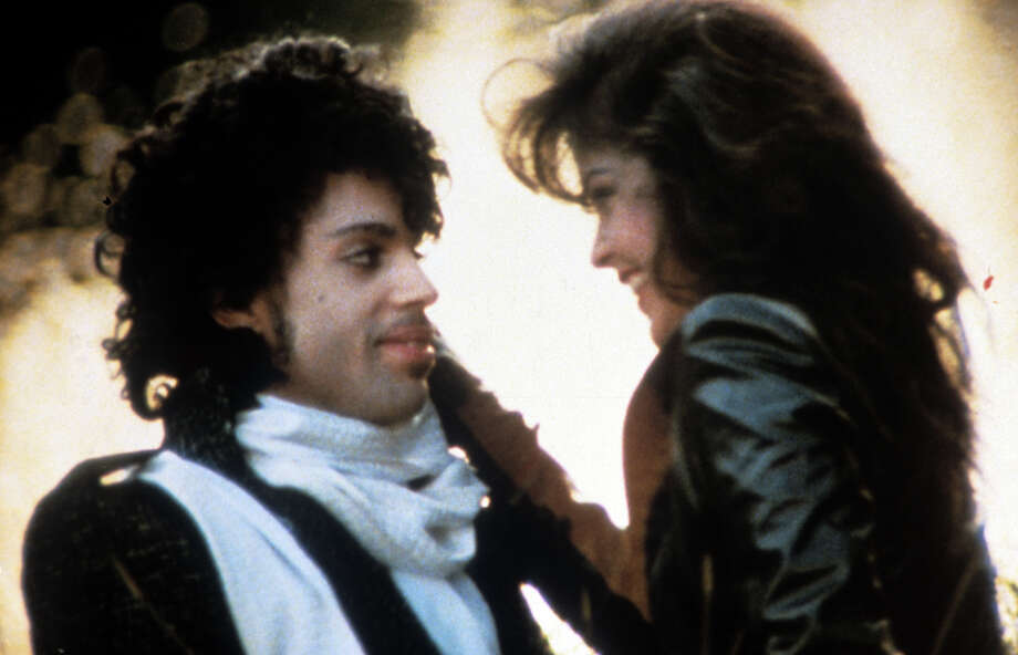"""Prince embraces Apollonia Kotero in a scene from the film """"Purple Rain,"""" 1984. Photo: Warner Bros., Getty Images / 2012 Getty Images"""