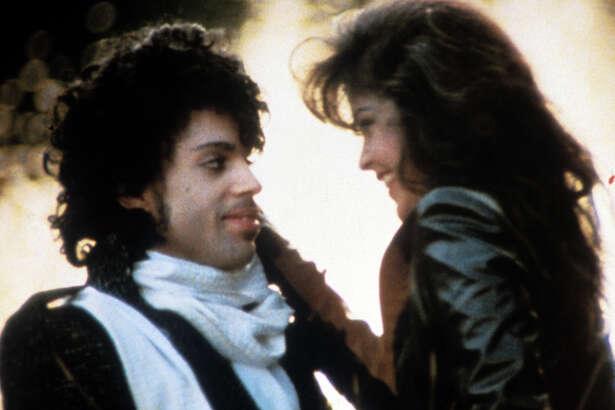 Prince embraces Apollonia Kotero in a scene from the film 'Purple Rain', 1984.
