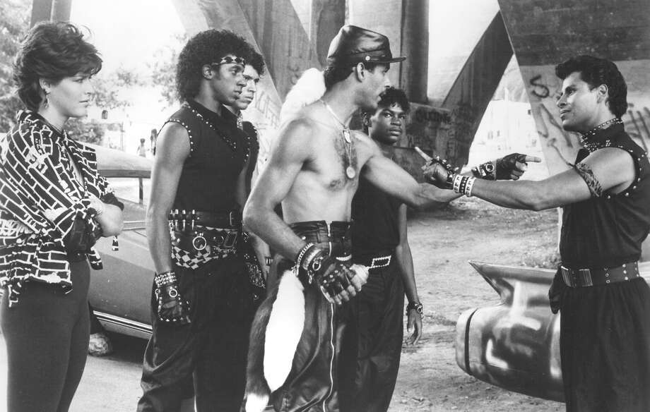"""Kelly (Lucinda Dickey), Ozone (Adolpho """"Shabba-Doo"""" Quinones) and Turbo (Michael """"Boogaloo Shrimp"""" Chambers) dare the Electro-Rockers to prove that they have great break-dance moves in """"Breakin' 2: Electric Boogaloo,"""" 1984. Photo: Tri-Star Pictures"""
