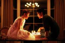 """In this 1984 film publicity image released by Universal Pictures, Molly Ringwald, left, and Michael Schoeffling are shown in a scene from """"Sixteen Candles."""" (AP Photo/Universal Pictures)"""