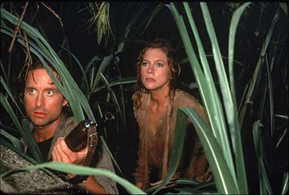 "Michael Douglas and Kathleen Turner are seen in a scene from ""Romancing the Stone,"" 1984. Photo: 20th Century Fox"