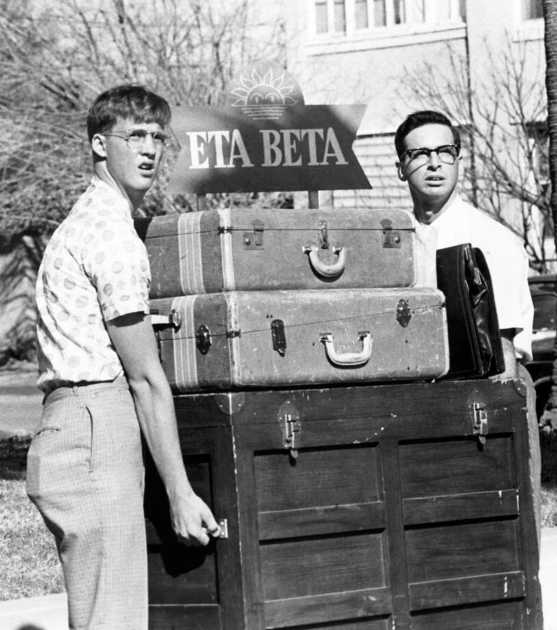 "Gilbert, played by Anthony Edwards, and Lewis, played by Robert Carradine, wonder what the future holds as they transport their belongings to the Adams College Freshman Dorm in the film ""Revenge of the Nerds,"" 1984. Photo: Anonymous, Associated Press / AP1984"