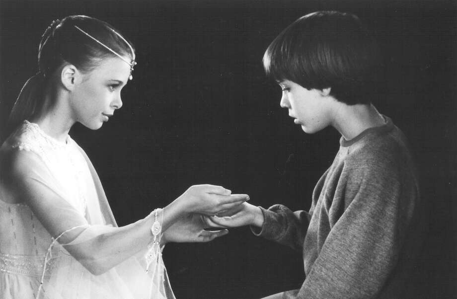 "The Empress (Tami Stronach) gives Bastian (Barret Oliver) a grain of sand, from which to rebuild the magical land of Fantasia, a mythical empire of fabulous beings in ""The Neverending Story."" Photo: Warner Bros."