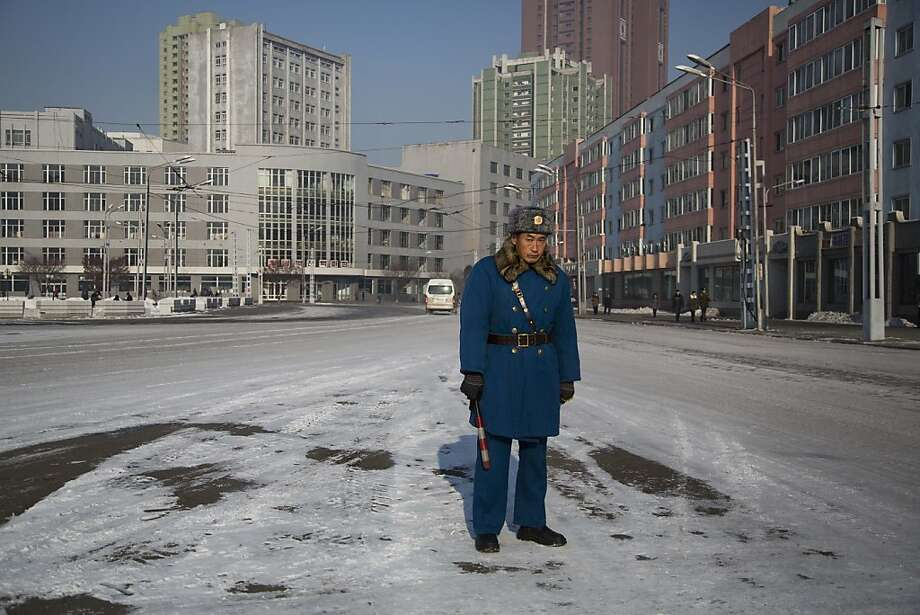Rush hour in Pyongyang: A traffic cop in the North Korean capital is as lonely as the Maytag repairman. Photo: David Guttenfelder, Associated Press