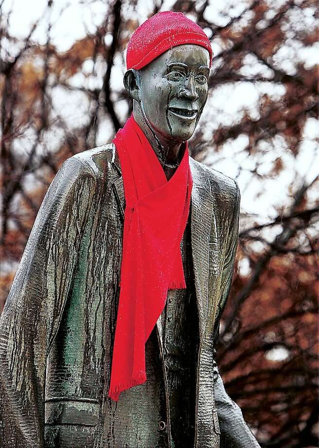 A tall cold one: Some thoughtful person put a cap and scarf on the statue of the world's tallest man, Robert 