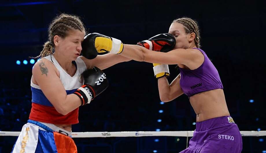 Ow, my nose: Olga Stavrova (left) of Russia and Christine Theiss of Germany land punches simultaneously during 
