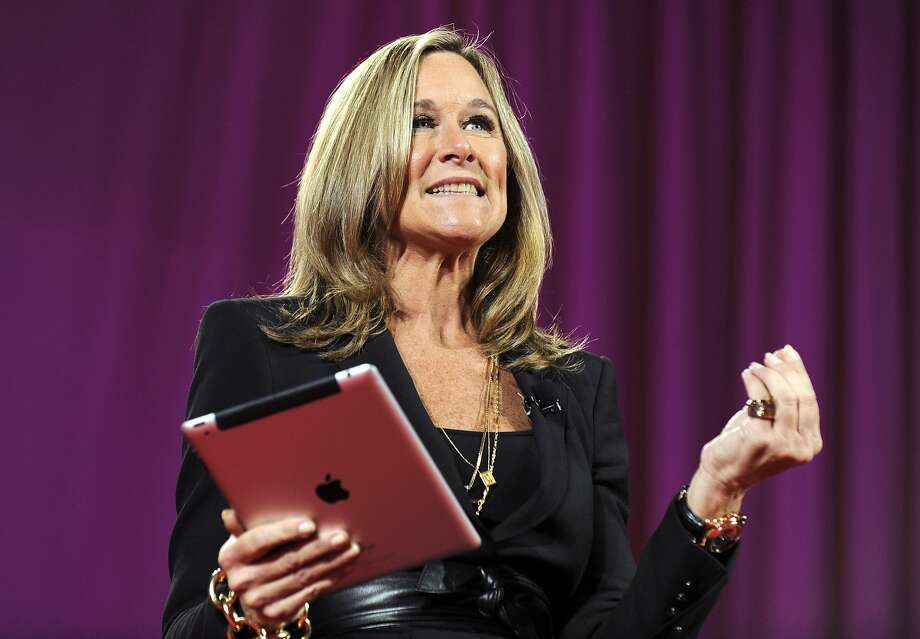 FILE PHOTO: Angela Ahrendts, chief executive officer of Burberry Group Plc, speaks as she holds an Apple Inc. iPad at the 2011 World Business Forum in New York, U.S., on Wednesday, Oct. 5, 2011. Burberry Group said Christopher Bailey will become chief executive officer of the largest British luxury-goods producer, as CEO Angela Ahrendts departs the company to work at Apple Inc. Photographer: Peter Foley/Bloomberg *** Local Caption *** Angela Ahrendts Photo: Peter Foley, Bloomberg