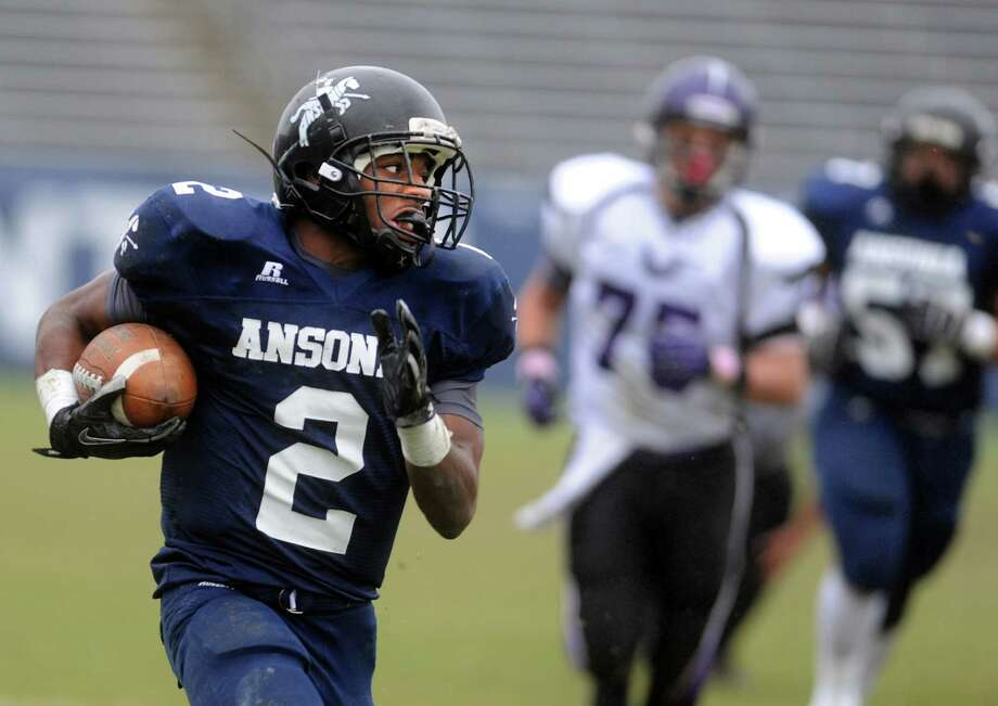 Ansonia's Arkeel Newsome carries the ball during the Class S state football championship game against North Branford Saturday, Dec. 8, 2012 at Rentschler Field in East Hartford, Conn. Photo: Autumn Driscoll / Connecticut Post