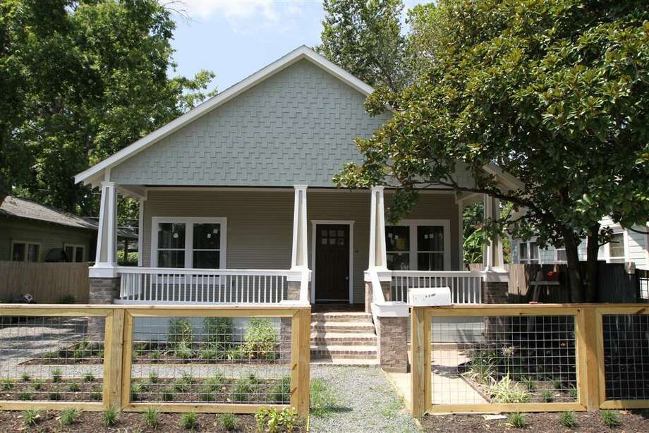 207 Vincent: This 1920 home has 2 bedrooms, 2 bathrooms, 1,200 square feet, and features custom cabinetry, carport with storage, and a large front porch. Listed for $375,000.