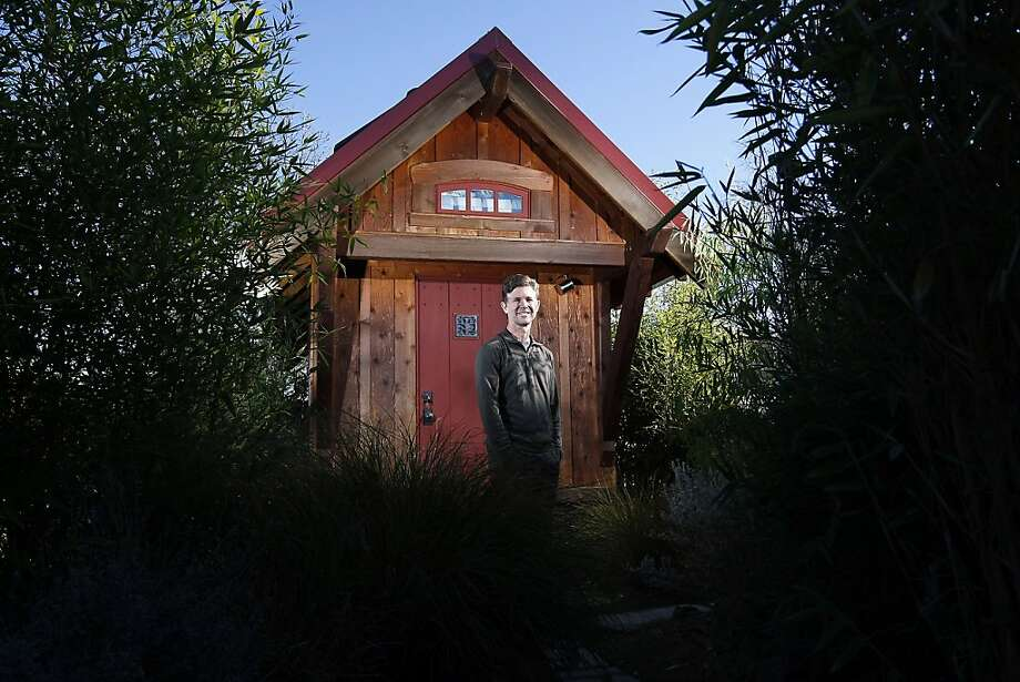 """Jay Shafer, owner of Jay Shafer's Tiny House Co., poses for a portrait in front of his 119 square foot """"Gifford"""" model house in Graton, CA Wednesday, December 4, 2013. Photo: Michael Short, The Chronicle"""