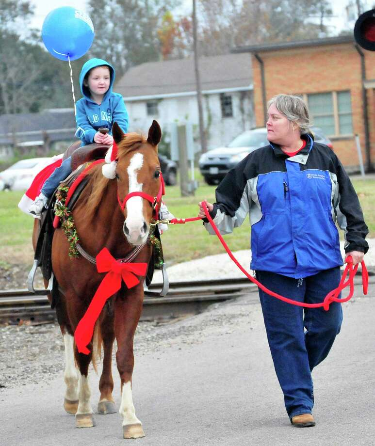 Residents enjoyed Christmas in the Big Thicket before the start of the Lighted Christmas Parade in downtown Silsbee on Saturday, Dec. 14. Photo by Cassie Smith/@smithcassie Photo: Cassie Smith/@smithcassie