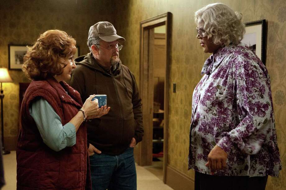 "This image released by Lionsgate shows, from left, Kathy Najimy, Dan Whitney, also known as Larry the Cable Guy, and Tyler Perry in a scene from ""Tyler Perry's A Madea Christmas."" (AP Photo/Lionsgate, KC Bailey) ORG XMIT: NYET636 Photo: KC Bailey / Lionsgate"
