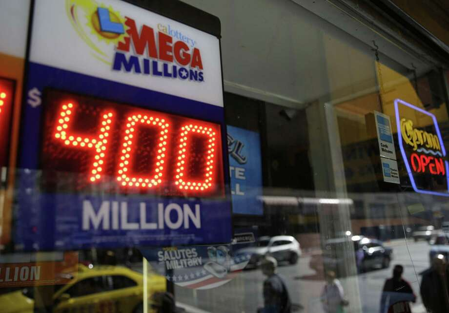 File-This Dec. 12, 2013 file photo shows a sign displaying the current Mega Millions jackpot at a Financial District liquor store in San Francisco.  Lottery officials say the next Mega Millions prize could surpass last year's record $656 million jackpot.  No one won the $425 million prize on Friday night. And officials Saturday Dec. 14, 2013, raised the amount to $550 million for Tuesday's drawing, the fourth-largest in U.S. history. Photo: Eric Risberg, AP / AP