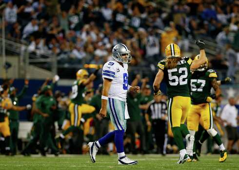 ARLINGTON, TX - DECEMBER 15:  Quarterback Tony Romo #9 of the Dallas Cowboys walks off the field after losing 37-36 to the Green Bay Packers during a game at AT&T Stadium on December 15, 2013 in Arlington, Texas. Photo: Tom Pennington, Getty Images / 2013 Getty Images