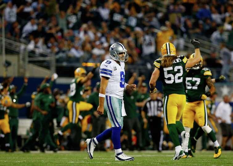 ARLINGTON, TX - DECEMBER 15:  Quarterback Tony Romo #9 of the Dallas Cowboys walks off the field aft