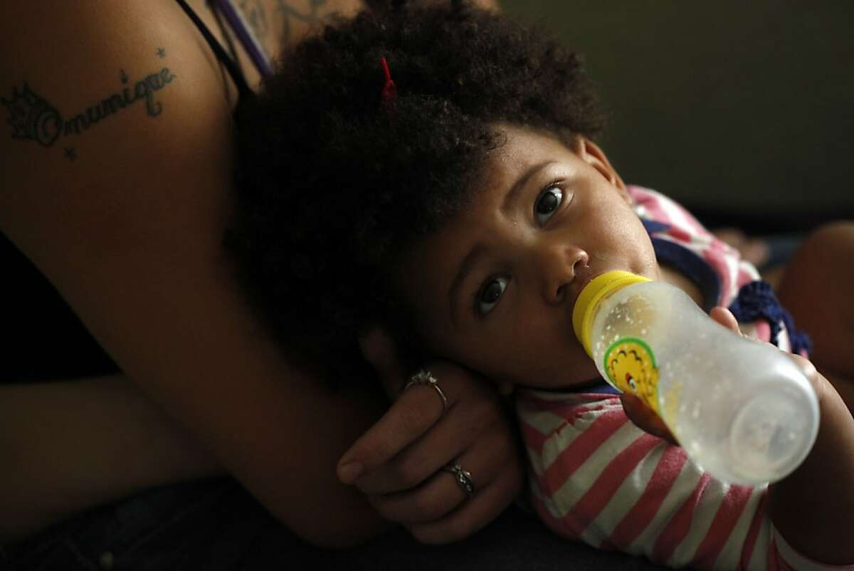 LaMya Deshana Price sucks on an empty bottle as she tries to fall asleep on her mother's lap on Wednesday, November 6, 2013, in Hayward, Calif. Photo: Lacy Atkins, The Chronicle