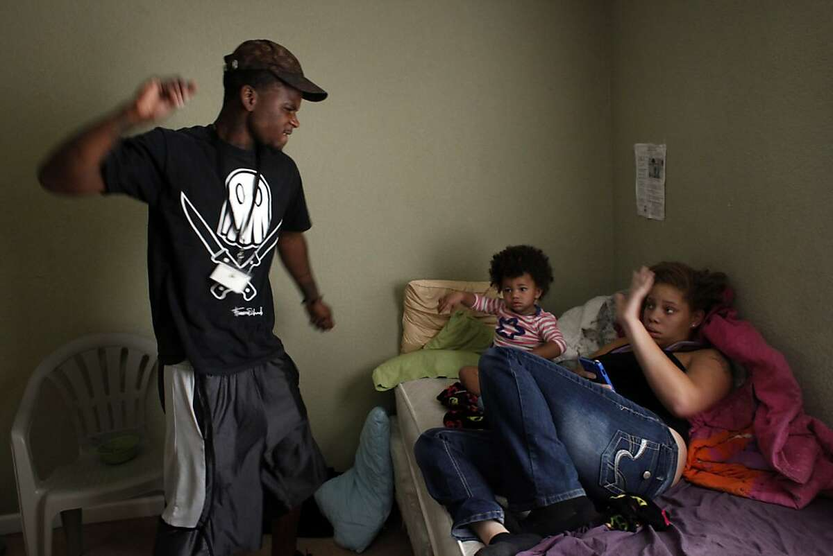 Quindell Anderson gets angry as he talks with his girlfriend Brijjanna Price while she cares for their daughter LaMya Deshana Price on Wednesday, November 6, 2013, in Hayward, Calif. Photo: Lacy Atkins, The Chronicle