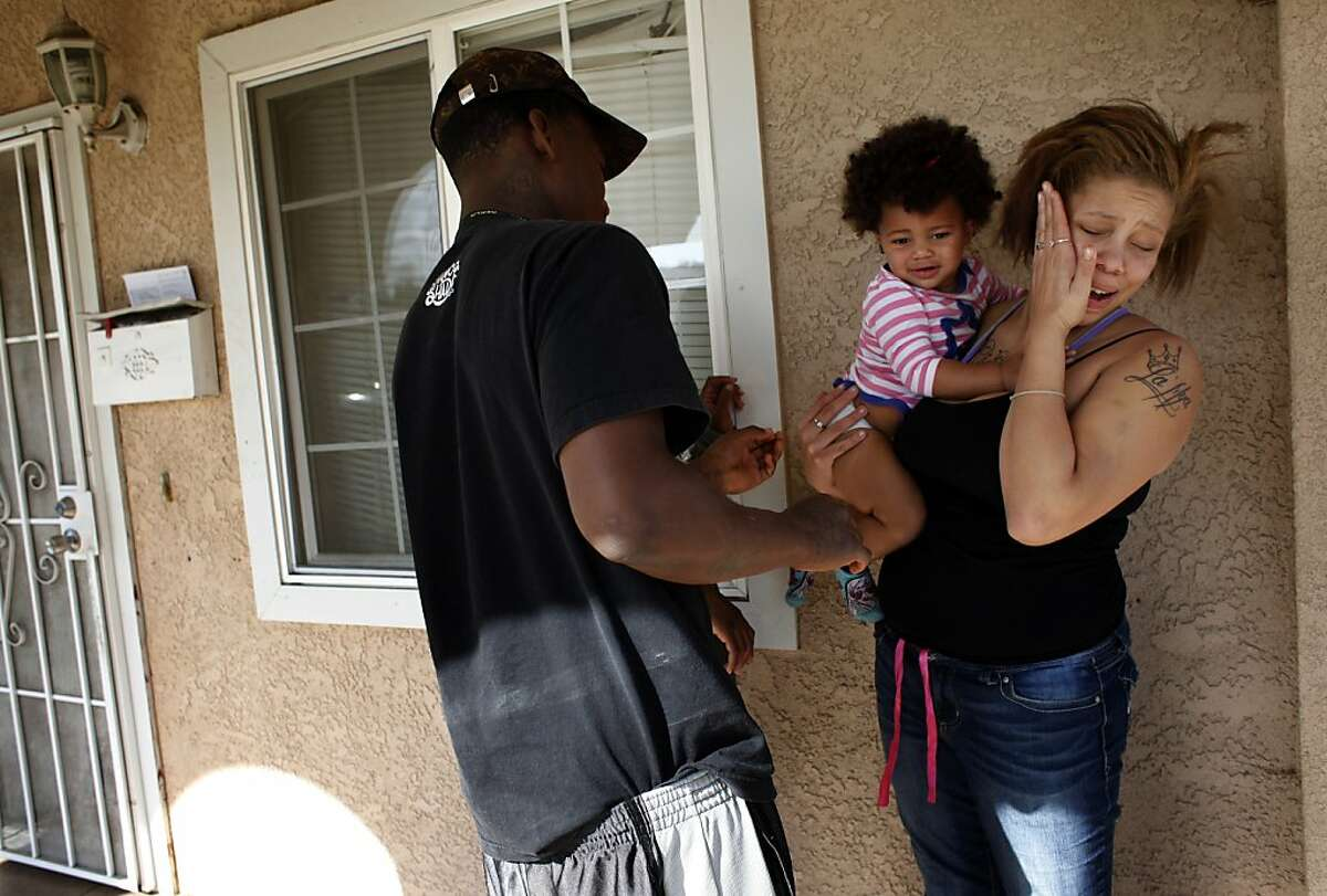 Brijjanna Price covers her face as her boyfriend Quindell Anderson yells at her about their daughter's dirty diaper on Wednesday, November 6, 2013, in Hayward, Calif. Photo: Lacy Atkins, The Chronicle