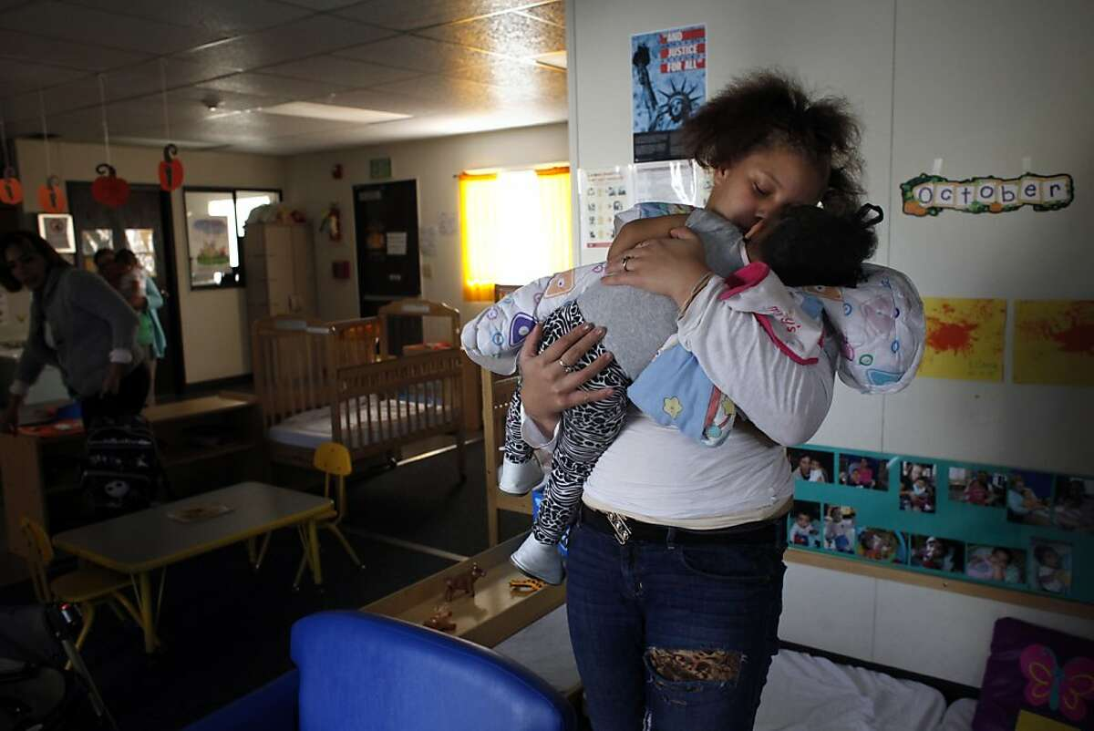 Brijjanna Price wakes her daughter LaMya up from her nap at daycare, Wednesday, October 23, 2013, in Oakland, Calif. Brijjanna attended the California School-Age Families Education (Cal-SAFE)  program when she discovered she was pregnant soon after her brother was killed and continued after giving birth. Photo: Lacy Atkins, The Chronicle
