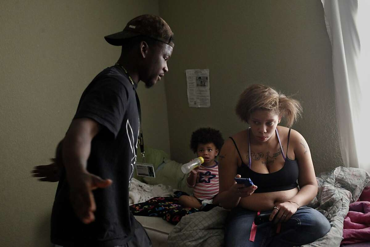 Quindell Anderson gets angry as he talks with Brijjanna Price while she sits on their bed next to their daughter LaMya Deshana Price, Wednesday, November 6, 2013, in Hayward, Calif. Photo: Lacy Atkins, The Chronicle