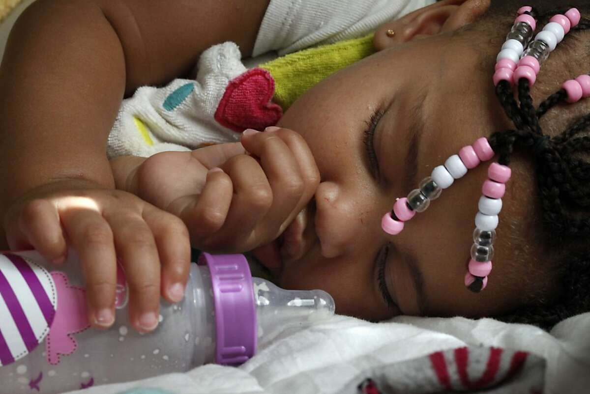 LaMya Deshana Price naps before her first birthday party at Chuck E. Cheese's, Saturday, November 9, 2013, in Hayward, Calif. LaMya was born November 8, 2012, just nine months after her uncle Lamont DeShawn price was shot and killed in east Oakland. Photo: Lacy Atkins, The Chronicle