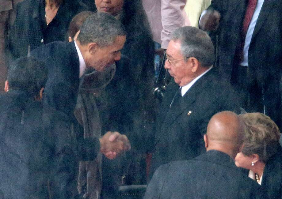US President Barack Obama's handshake with Cuban President Raul Castro wasn't well received by Sen. John McCain who compared it to then Britain Prime Minister Neville Chamberlain's handshake with German dictator Adolf Hitler. Here are some of the Obama-Hitler comparisons from his presidency.  (Photo by Chip Somodevilla/Getty Images) Photo: Chip Somodevilla, Getty Images