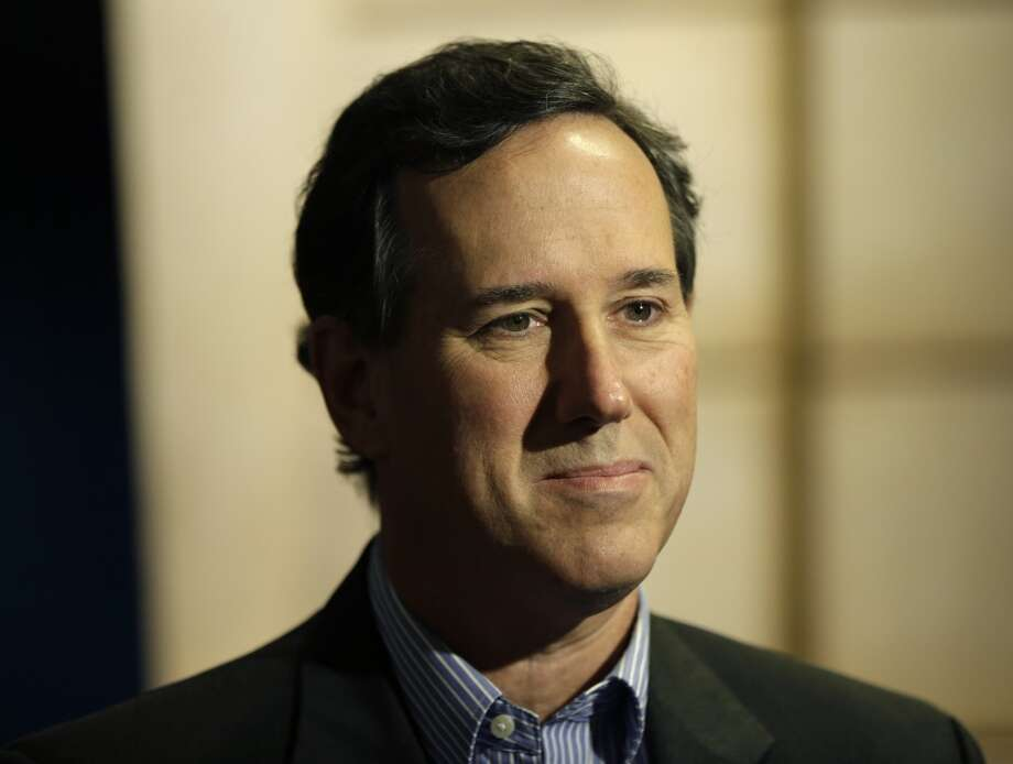 "Then GOP presidential candidate Rick Santorum compared the election to the early 1940s when Americans didn't act against Adolf Hitler. ""It's going to be harder for this generation to figure this out. There's no cataclysmic event,"" he said. (AP Photo/Seth Wenig) Photo: Seth Wenig, Associated Press"