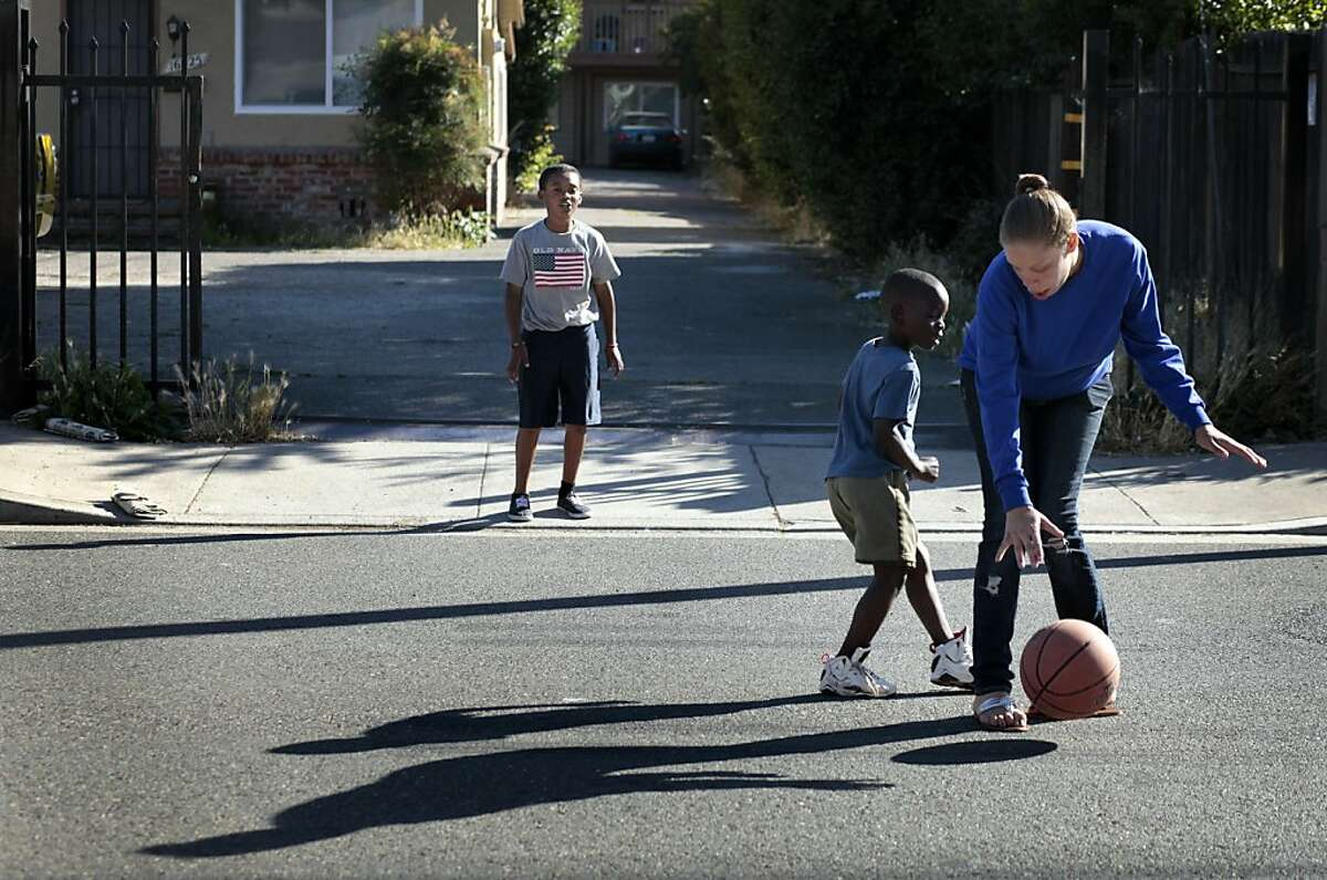 Brijjanna Price plays basketball with Shaun Brownwith, left, and  Kalem McCoy, Sunday June 3, 2012, near her grandmother's home in San Leandro, Calif. Photo: Lacy Atkins, The Chronicle