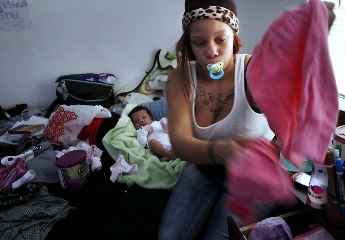 Brijjanna Price,16, cares for her newborn daughetr, La'Mya Deshana Price, Tuesday December 4 , 2012, at her godmothers house in Oakland, Calif. Photo: Lacy Atkins, The Chronicle