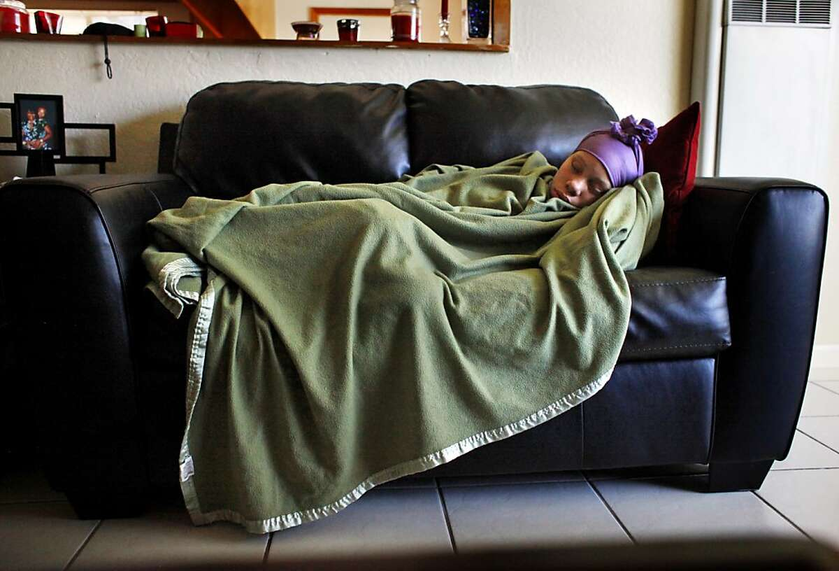 Brijjanna Price, 16, sleeps on the couch, Friday April 20, 2012, in her father's home in Antioch, Calif. The pregnant teenager suffers from depression and lack of motivation since the killing of her brother, Lamont Price, who was 17 when he was shot to death. Photo: Lacy Atkins, The Chronicle