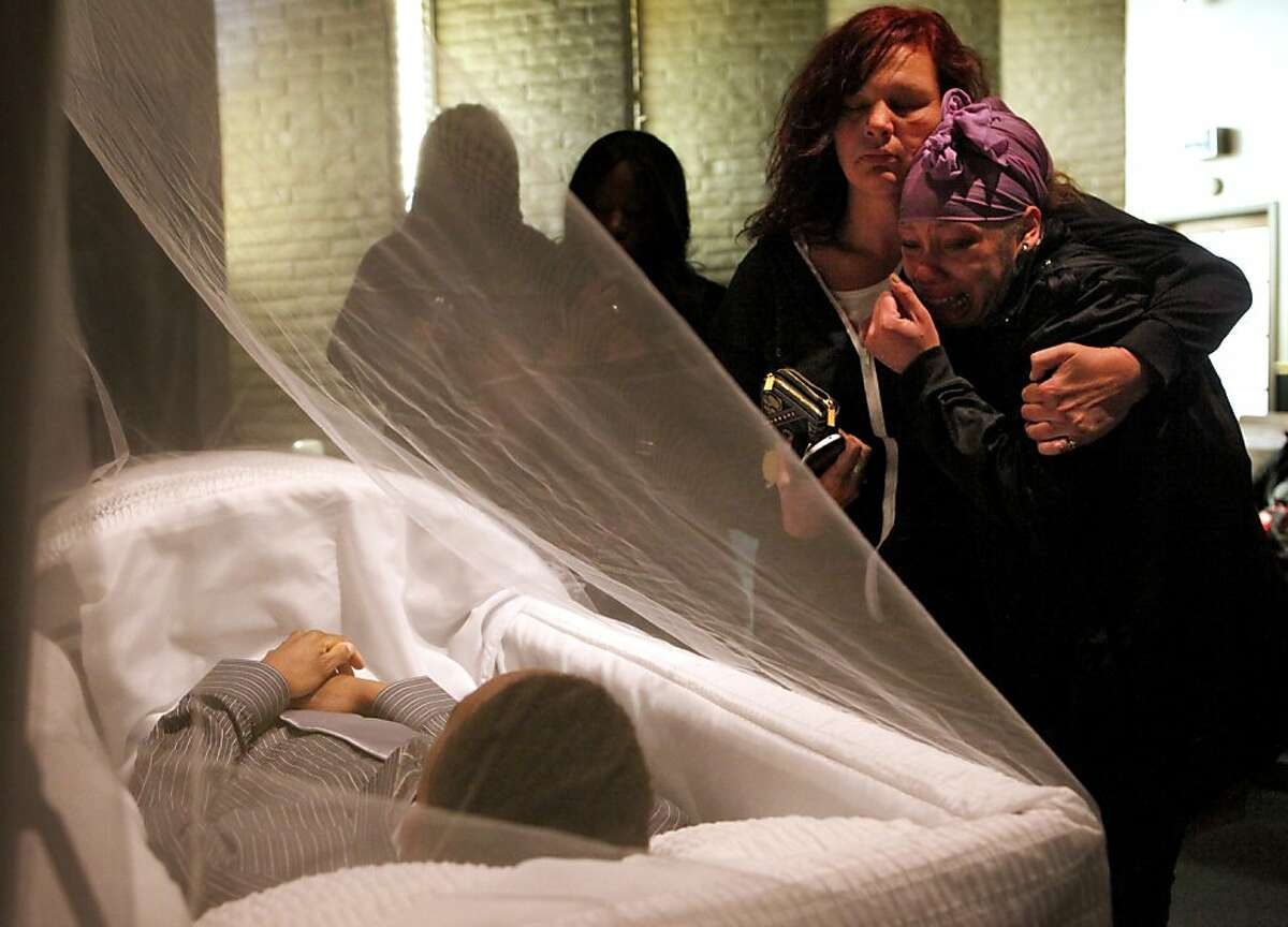 Sherri Miller, left , comforts Brijjanna Price, 16, as she sees her brother Lamont DeShawn Price, 17, in his coffin at the Whitted-Atkins Funeral Home, Wednesday Feb. 28, 2012, in Oakland, Calif. Lamont was shot and killed on Feb. 16, in the 8100 block of Birch St. Photo: Lacy Atkins, The Chronicle