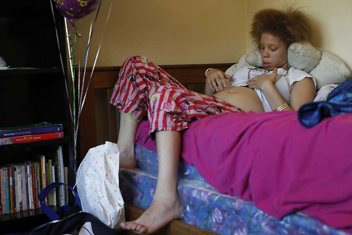 Brijjanna Price, 16, talks to her stomach after learning that she was two months pregnant in April of 2012, in Antioch, Calif. Photo: Lacy Atkins, The Chronicle