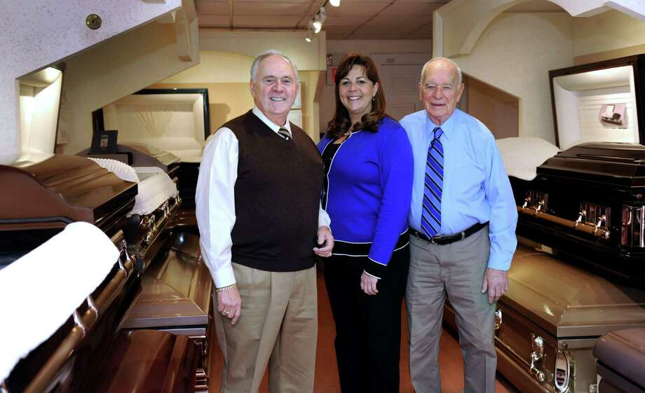 Cornell Memorial Home, on White Street in Danbury, Conn., has been in business for 100 years.  From left are Rodney Bourdeau, his daughter, Tania Porta, and Roger E. Gavagan, brother-in-law. Photo: Carol Kaliff / The News-Times