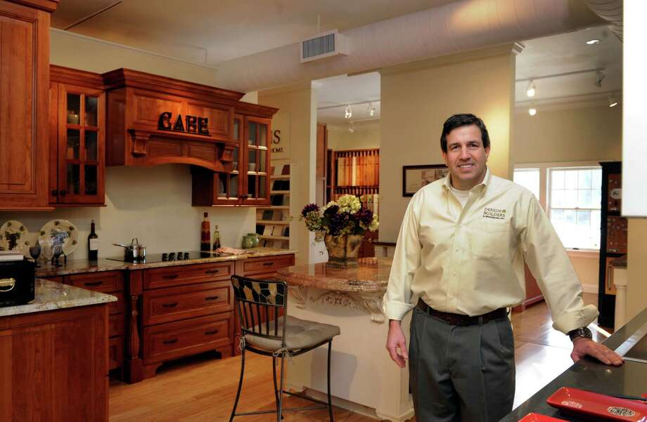 David H. Adams, 47, of Newtown, Conn. is the owner of Design Builders & Remodeling, Inc. in Ridgefield.  He is photographed in a transitional style kitchen - a combination of modern and traditional design, Monday, Dec. 16, 2013. Photo: Carol Kaliff / The News-Times