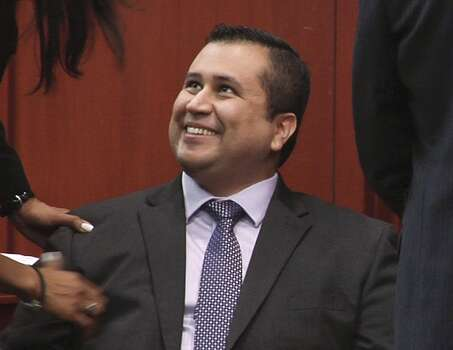 George Zimmerman smiles after jurors handed down a not-guilty verdict, July 13, 2013, in Sanford, Fla. 