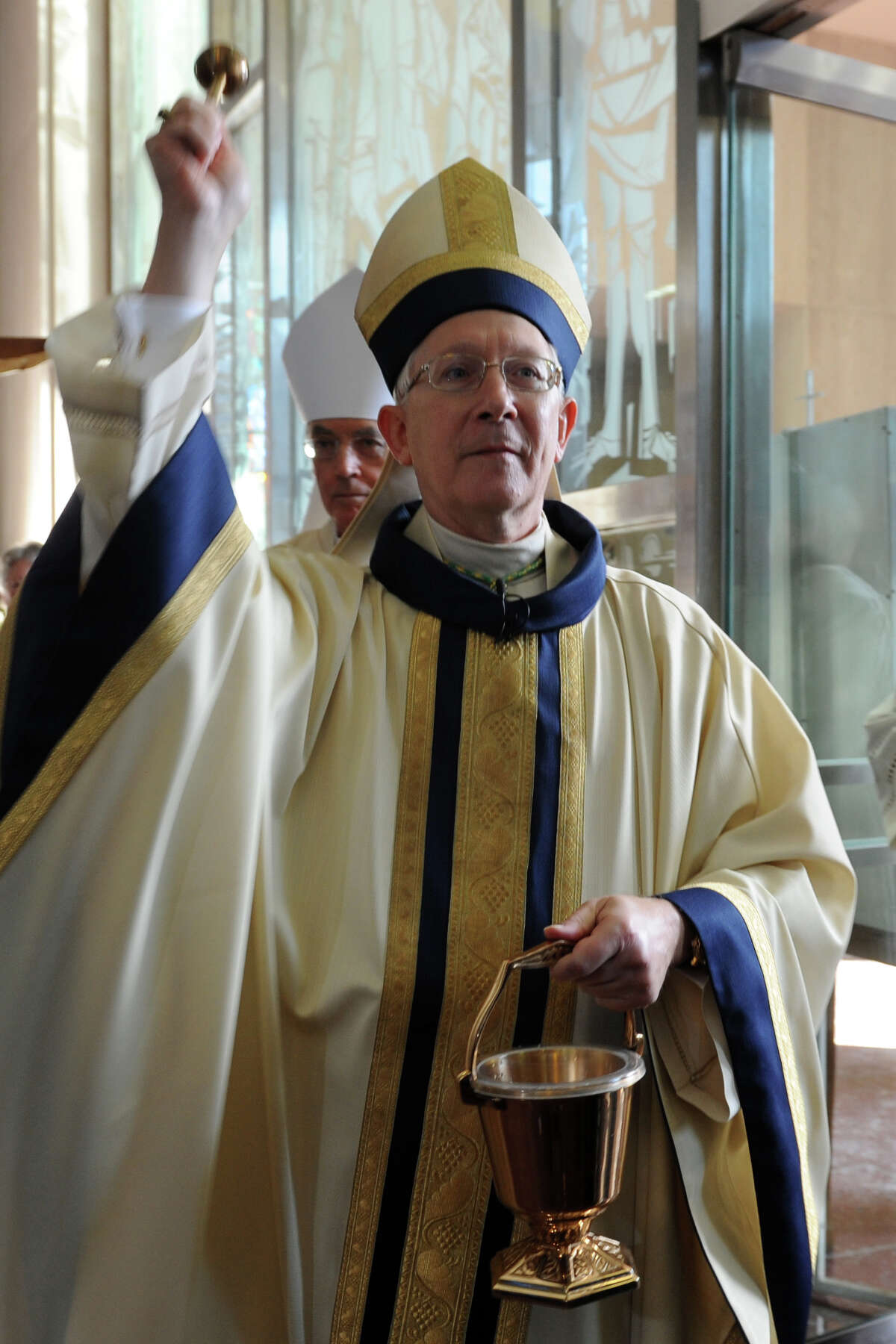 Archbishop Leonard P. Blair enters the Cathedral of Saint Joseph for his Mass of Installation in Hartford, Conn., Dec. 16, 2013.