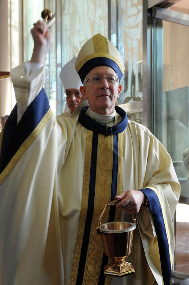 Archbishop Leonard P. Blair enters the Cathedral of Saint Joseph for his Mass of Installation in Hartford, Conn., Dec. 16, 2013. Photo: Ned Gerard / Connecticut Post