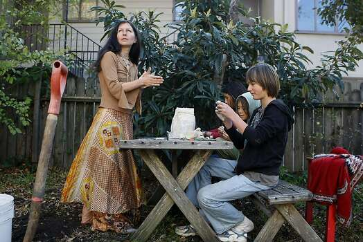 Nudity activist Gypsy Taub (left) homeschools her children - Inti, Daniel and Nebosvod - in their Berkeley backyard. Photo: Michael Short, The Chronicle