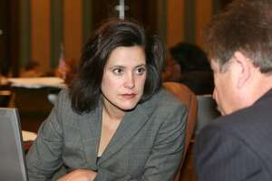 FILE - This undated file photo provided by the Michigan Legislature shows state Sen. Gretchen Whitmer, of East Lansing, Mich., leader of the Democratic minority in the Senate. She cited her own rape in criticizing the Republican-controlled Legislature's final approval Wednesday, Dec. 11, 2013, of a bill that bans commercial insurance policies from covering abortions, unless the woman covered buys a separate rider to include abortion services. There is no rape exception, in the bill, which allows abortion coverage if the woman's life is endangered. (AP Photo/Michigan Legislature, File)