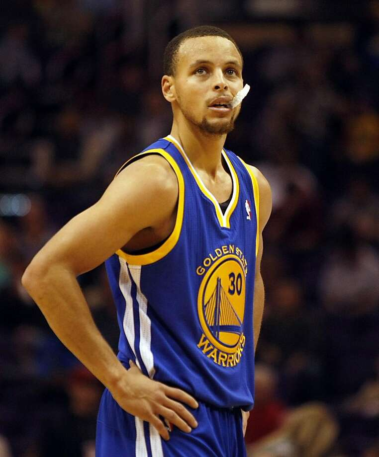 Golden State Warriors point guard Stephen Curry (30) against the Phoenix Suns in the second quarter during an NBA basketball game, Sunday, Dec. 15, 2013, in Phoenix. The Suns defeated the Warriors 10-102. (AP Photo/Rick Scuteri) Photo: Rick Scuteri, Associated Press