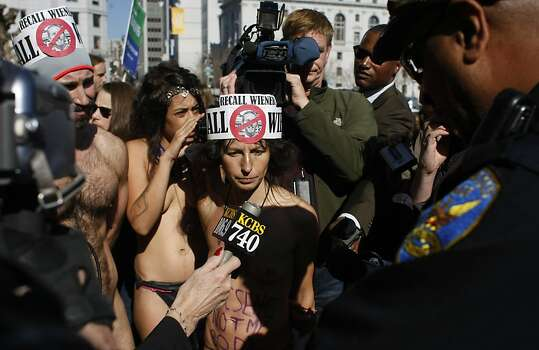 Gypsy Taub (center) is among those who disrobed at City Hall in February to protest San Francisco's then-new ban on public nudity, which Taub continues to fight - often in the buff. Photo: James Tensuan, The Chronicle