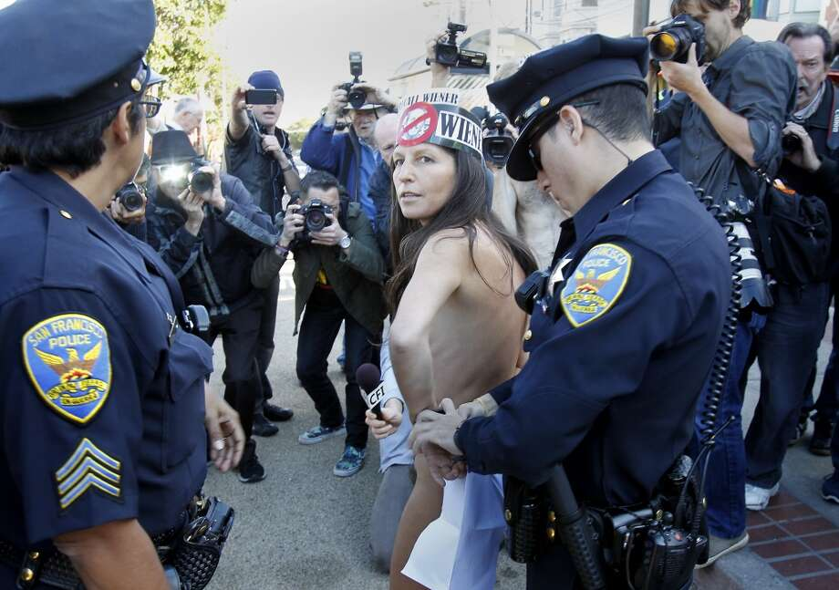 Gypsy Taub, who led the rally, is handcuffed by police Sunday November 17, 2013 in San Francisco, Calif. Police arrested and cited a group of nudists who staged a rally at the corner of Market and Castro Streets, violating the city's nudity ban. Photo: Brant Ward, The Chronicle