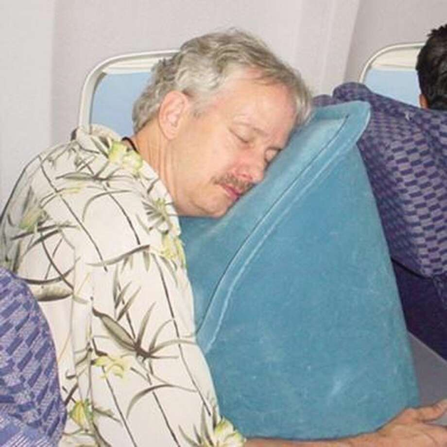 No. 6: The Sky Rest (Sky Mall). It's a giant inflatable wedge for sleeping better on planes. Drink service? Deflate. Meal service? Deflate. Restroom break? Deflate. The reason you sleep so well is because you're hyperventilating from blowing this thing up. (And at 14-inches wide, it pretty much forces you to hog the armrests on both sides of your 16-inch seat.) http://www.skymall.com/skyrest-travel-pillow/99010.html Photo: SkyMall.com