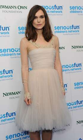 Dec. 3: Actress Keira Knightley proves herself an avid sartorial recycler, sporting the blush-hued Chanel haute couture dress she wore at her May 2013 wedding for a third time at the SeriousFun gala in London. She was first spotted in the tea-length tulle frock in 2008 at a British film awards pre-party. Photo: Stuart C. Wilson, Getty Images