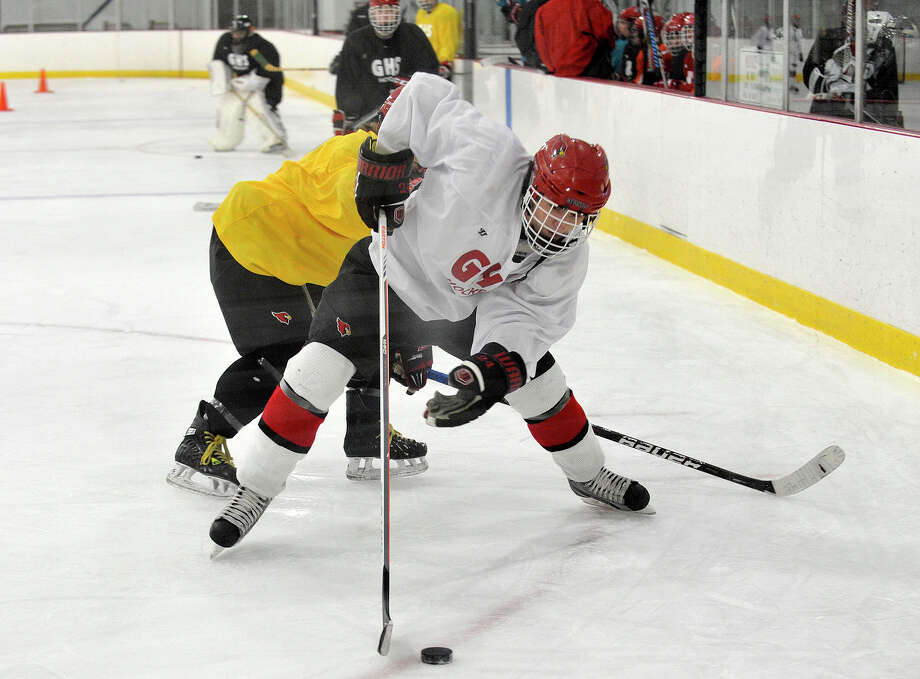 Greenwich's Mark Schmeiler shields the puck from the defense during a scrimmage at Dorothy Hamill Skating Rink in Greenwich, Conn., on Monday, Dec. 16, 2013. Photo: Jason Rearick / Stamford Advocate