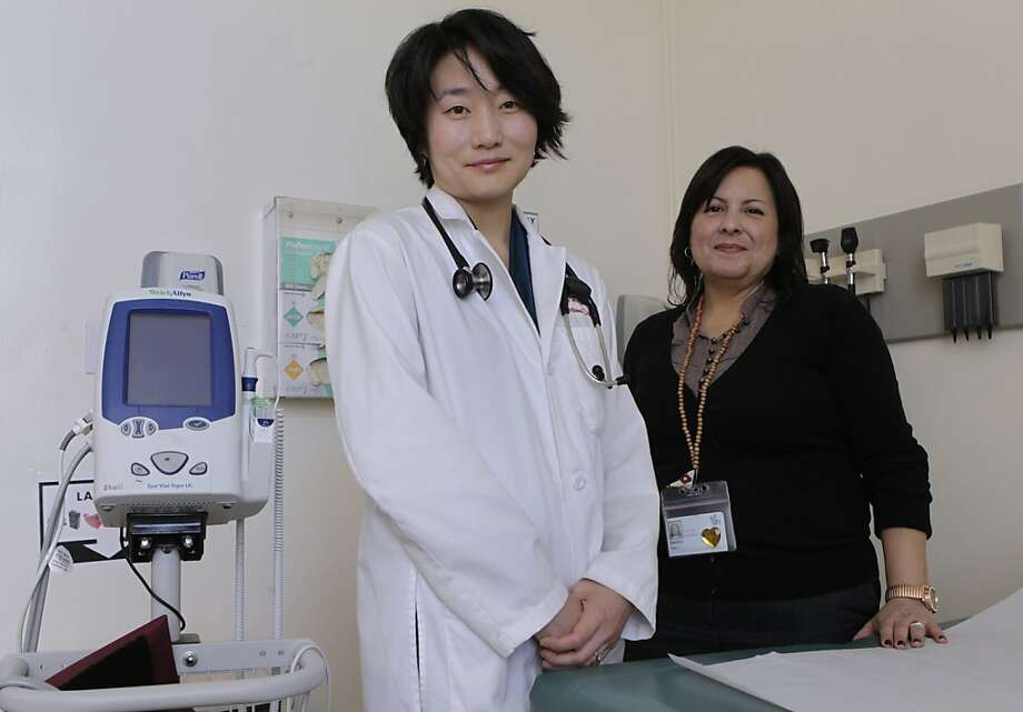 Dr. Hiroyu Hatano (left) stands with social worker Sandra Torres at the HIV clinic at San Francisco General Hospital. Photo: Paul Chinn, The Chronicle