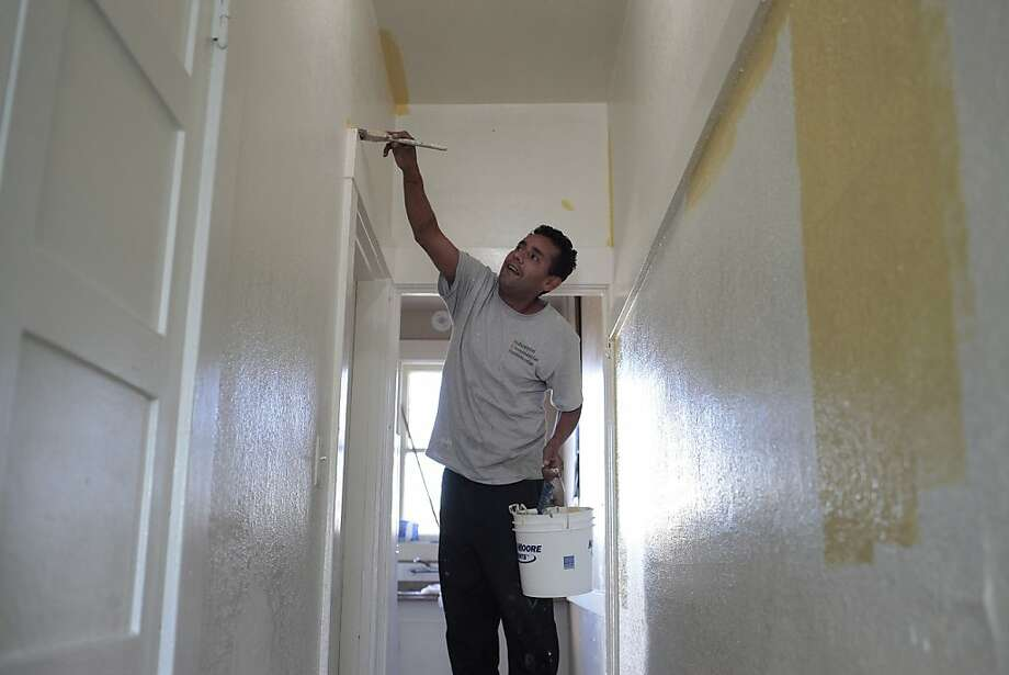 Raul Rivas, painting his home in Oakland, was diagnosed with high blood-lead content in 2010, as was his daughter. Most housing units in San Francisco and Alameda County were built before lead was banned in house paint. Photo: James Tensuan, SFC